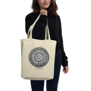 This is an image of a tote bag with a black and white mandala printed in the front. The bag is made from organic cotton