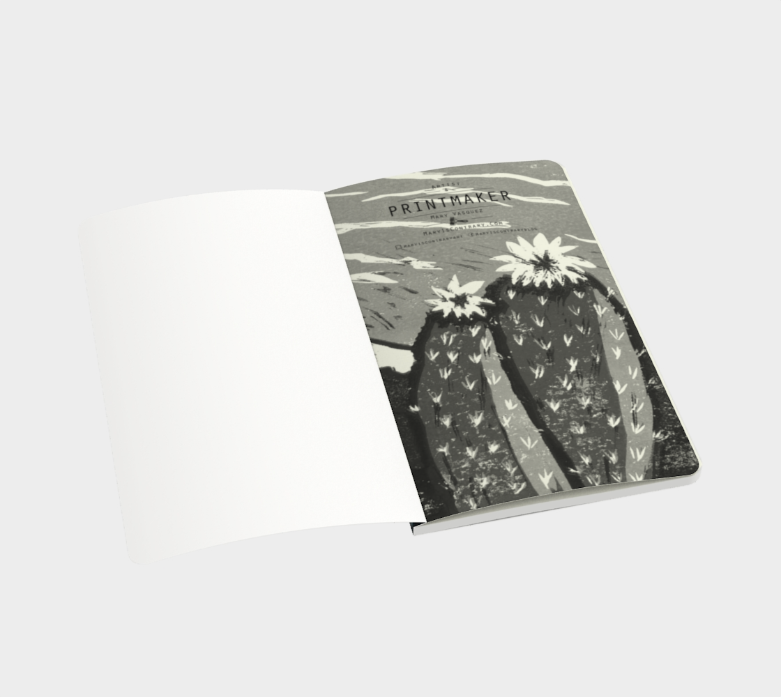 This is an image of the inside of a notebook which is made to order, the page includes a black and white image of two cactus flowers